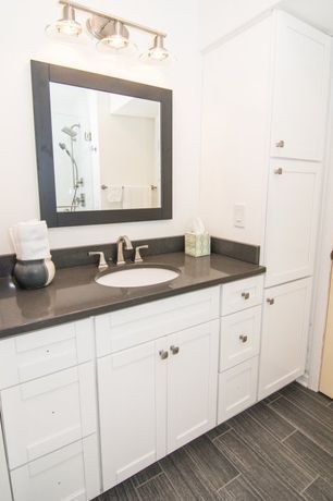 Traditional Master Bathroom with Silt Solid Surface Countertop, Corian, Handheld Shower Head, specialty door, Master bathroom