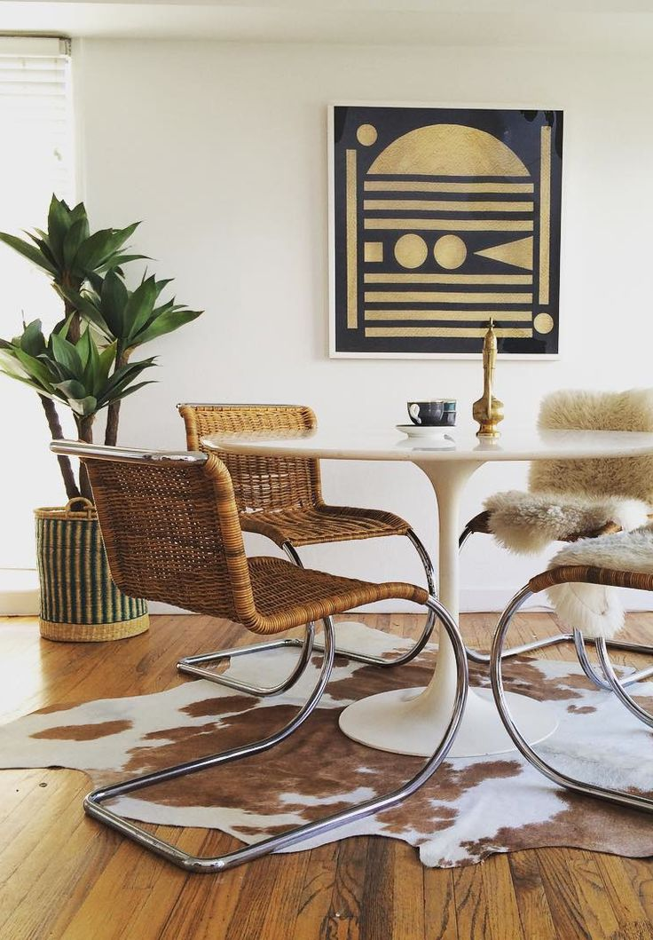 retro midcentury eclectic dining room with tulip table via @citysage https://emfurn.com/
