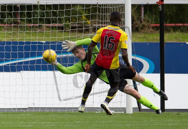 Queen's Park's Andy Murphy makes a save during the Betfred Cup game between Partick Thistle and Queen's Park.