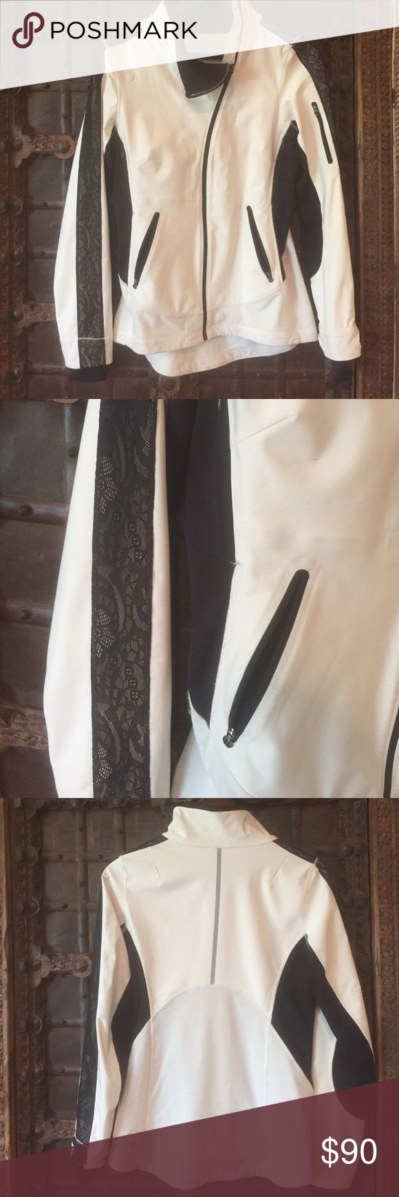 Lululemon Addict Draft Dodger Jacket Size 6 Lululemon Addict Draft Dodger jacket. Very cute Lululemon jacket size 6. Off-white with black accents and black lace down the arms. Lightweight with warm trim. Thumb holes. lululemon athletica Jackets & Coats