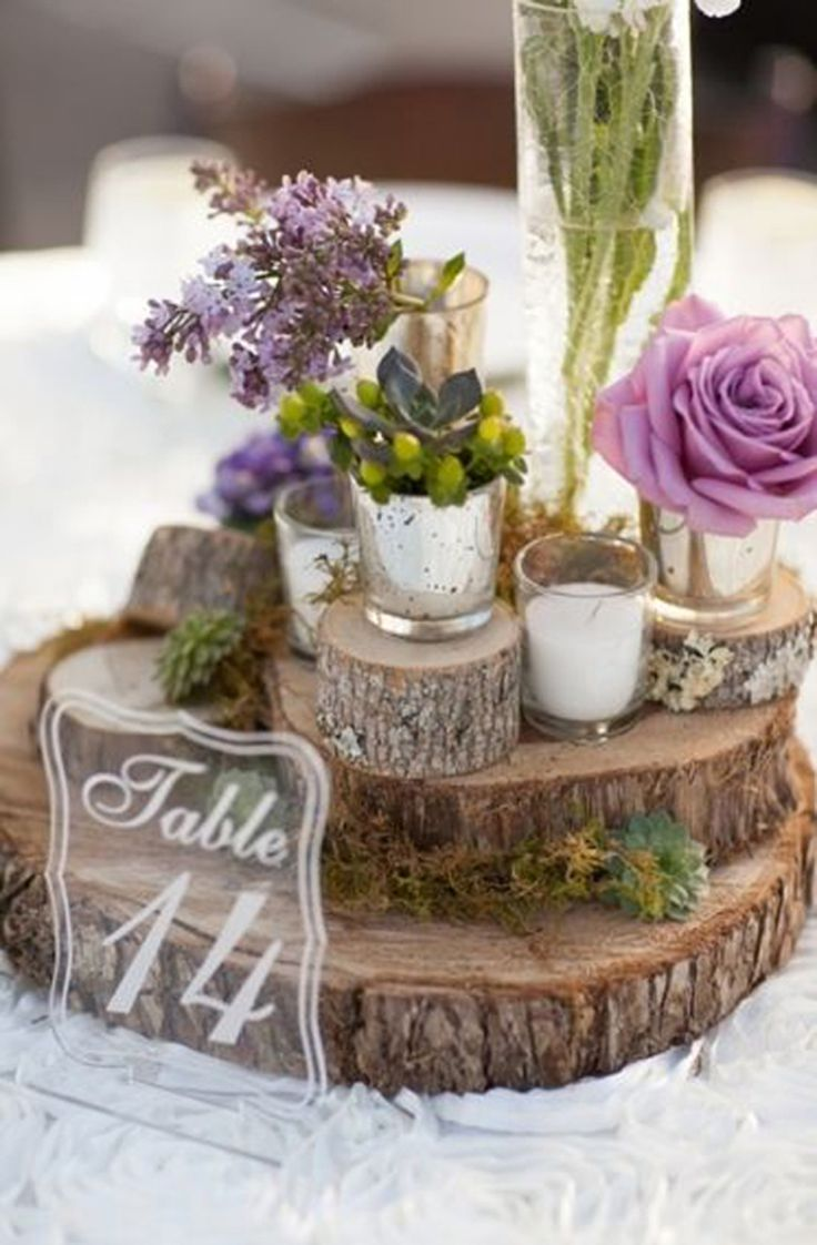 Purple wedding centerpiece with clear acrylic table number, rustic wood slabs, gold Mercury glass votives