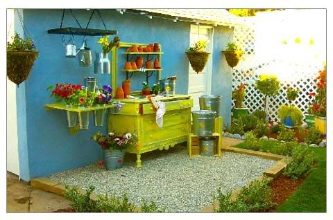 Great potting area.  Love the re-used pot rack and the flower holders.  I'm pretty sure all the ingredients are piled in my barn.