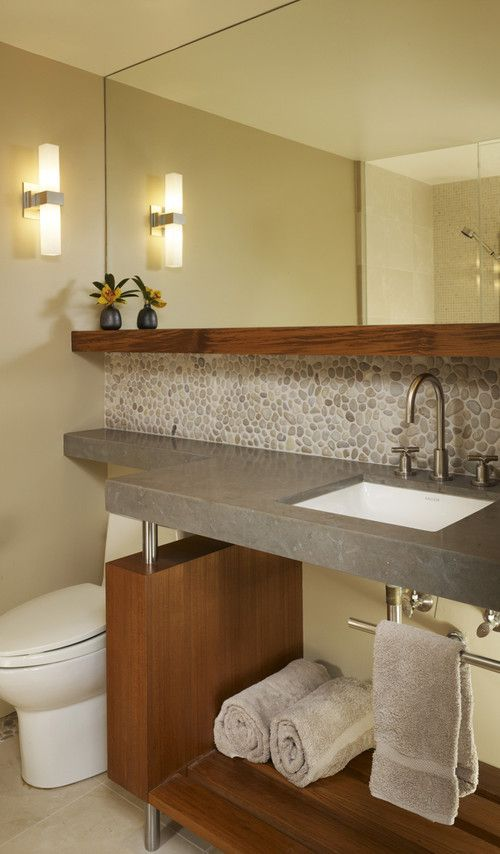 contemporary bathroom by Michael Tauber Architecture - wood shelf and  backsplash of riverrock