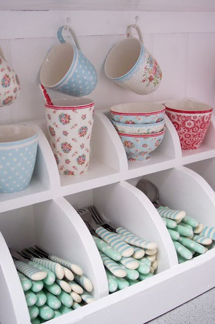 What a Lovely way to display and store the key cutlery and china, amazing for the kids to get use to!