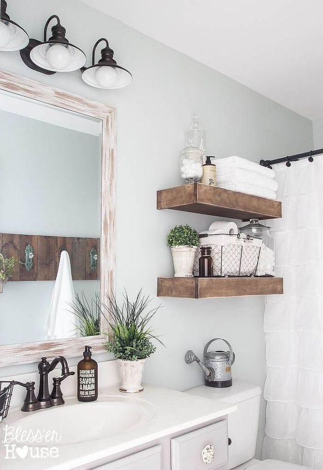 Gorgeous wooden open shelving in bathroom