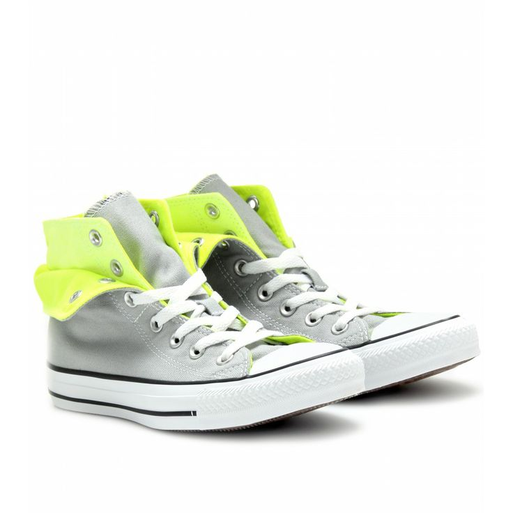 Converse presents a much loved classic with a contemporary twist. A  chromatic kick of highlighter yellow contrasts with an understated shade of  gray come ...