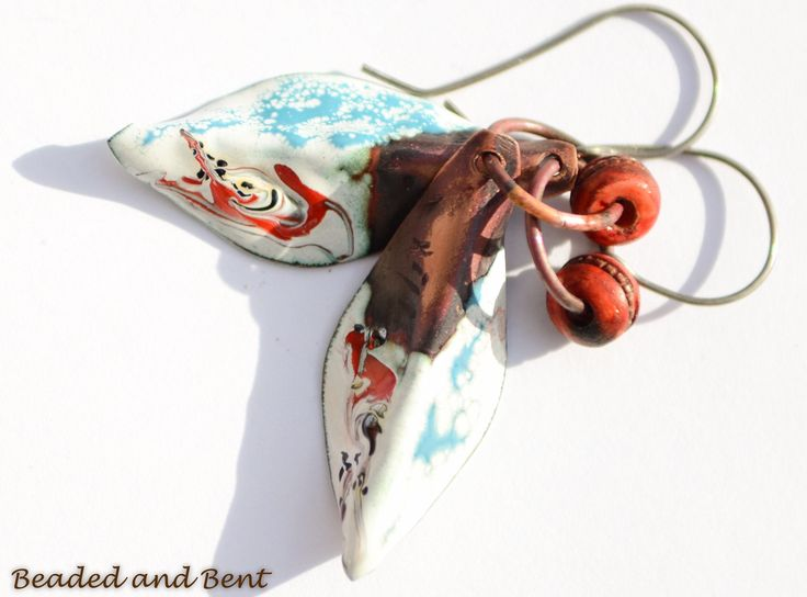 A personal favorite from my Etsy shop https://www.etsy.com/ca/listing/555189534/rustic-enamelled-copper-leaf-dangles