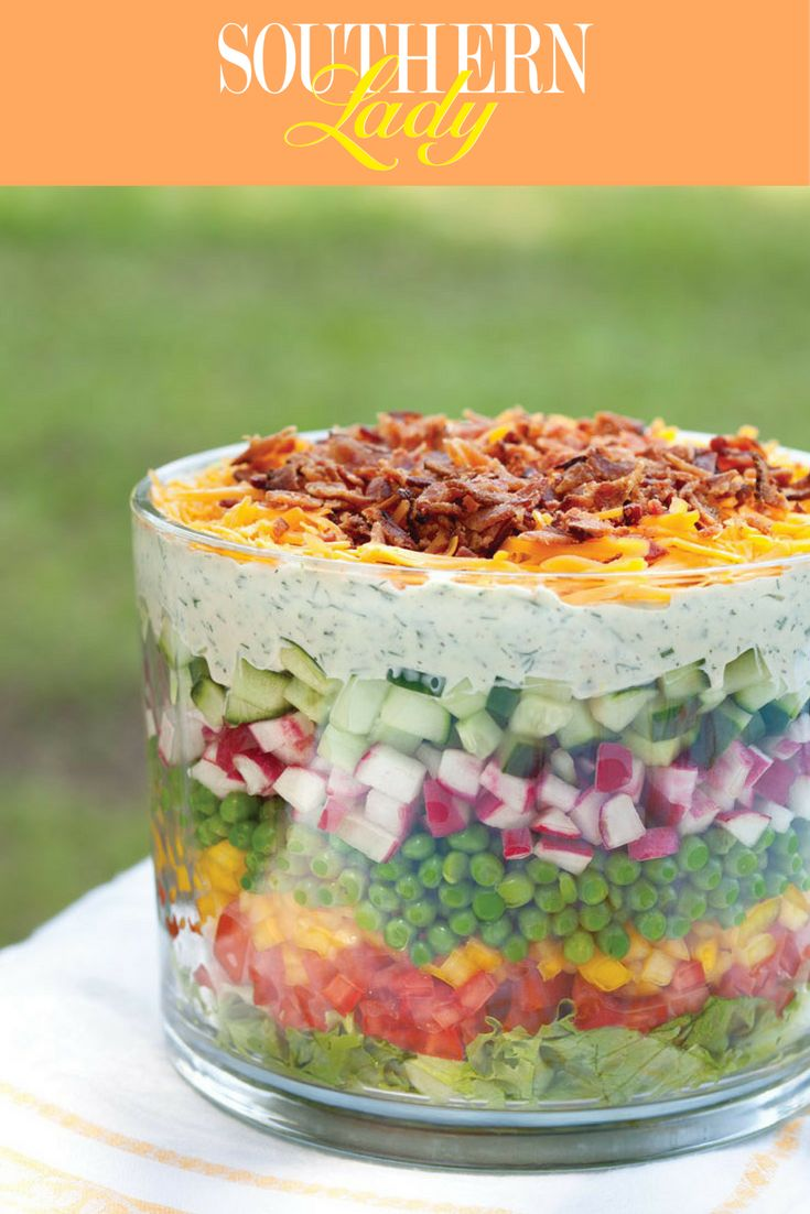 There are some recipes that we simply never tire of, those we return to again and again much to the pleasure of our family and friends. Combining the fresh flavors and eye-catching colors of summer, our favorite Seven-Layer Salad truly is as lovely as it is delicious.