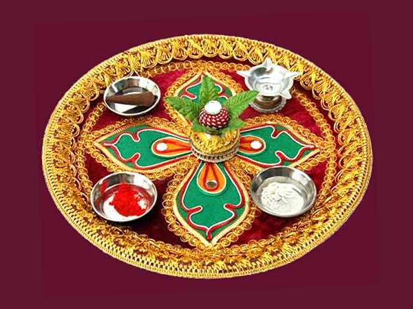 Decorative Thali is a metal plate being decorated for various indian festival and occasions.