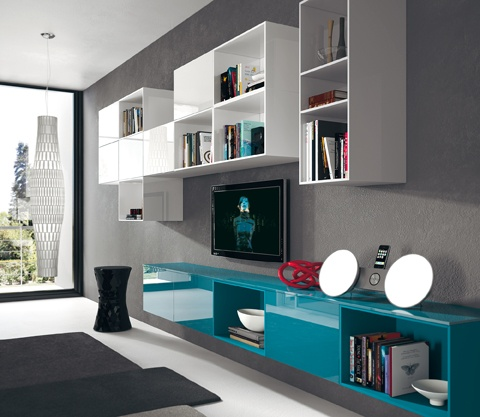 Tetrix. The array of elements available allows  for endless modularity: in this case,  for instance, warned units are placed  flush with the base unit (there are also  wall-mounted elements for the living  area) and allows to separate the kitchenrelated  functions from those reserved for  relaxation. Although separate, the two  living dimensions life retain, with glossy  finishes and choice of colour, the same  identity.