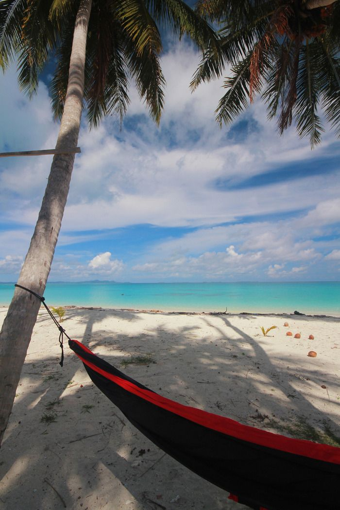 An island for yourself. With a hammock and a good book, you are ready to spend the day relaxing on this warm beach. It should come as no surprise if you fall asleep easily in the calm weather. Photo by Tekno Bolang