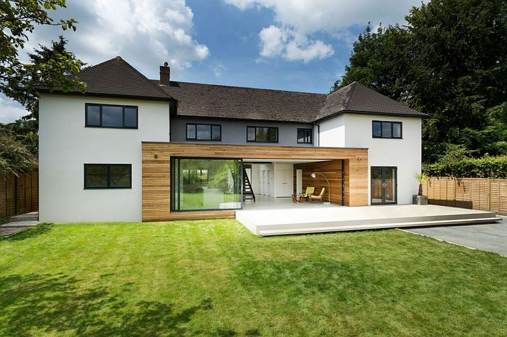 Classic english home gets a grand contemporary update in for Traditional and modern houses