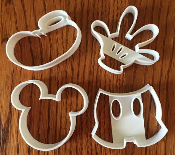 Welcome to Three D Geek! This listing includes a Mickey Mouse four piece set of cookie cutters made on our 3d printer! All cookie cutters are MADE TO ORDER!  Our cookie cutters are made from food safe PLA plastic.  PLA is a biodegradable plastic.  Please hand wash your cookie cutter. The high heat of a dishwasher might warp the plastic.  The color of your cookie cutter may vary.  Please choose your size above. Size listed is the HEIGHT of the cookie cutter from the top of the image to the…