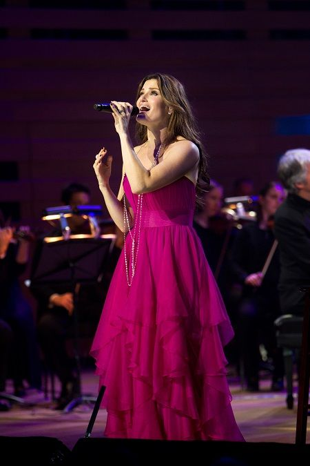 """http://triangleartsandentertainment.org/wp-content/uploads/2015/07/IdinaMenzelPHOTO1-RedHat2015.jpg - Broadway Star Idina Menzel Will Twinkle on July 22nd in Raleigh's Red Hat Amphitheater - The """"Idina Menzel World Tour"""" will play Raleigh's Red Hat Amphitheater at 8 p.m. on Wednesday, July 22nd (photo by Robin Wong) Award-winning Broadway and movie star Idina Menzel will twinkle brightly, starting at 8 p.m. on Wednesday, July 22nd, in Raleigh's Red Hat"""