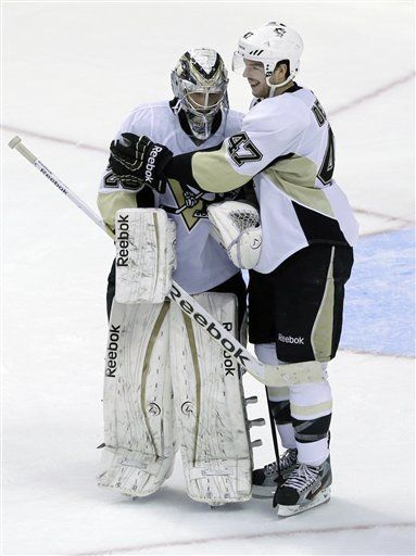 Pittsburgh Penguins' Simon Despres greets goalie Marc-Andre Fleury after defeating the Philadelphia Flyers  3-1 in an NHL hockey game Saturday, Jan.19, 2013, in Philadelphia. (AP Photo/Mel Evans)