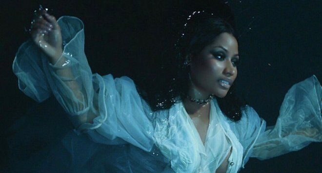 """Watch Nicki Minaj's New Music Video For 'Regret In Your Tears'  Nicki Minaj just released the video for """"Regret In Your Tears"""" which was shot by fashion photographers Mert Alas and Marcus Piggott. (He previously worked with Madonna on the music video of """"Girl Gone Wild."""") The """"Anaconda"""" singer continues to overhaul her image with her three latest singles, """"Regret In Your Tears"""", """"No Frauds"""" and """"Changed It."""" This time, Nicki Minaj"""