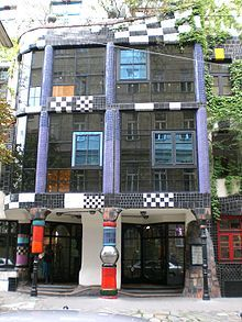 """Eco-social. Kunst Haus Wien, Vienna, Austria, Hundertwasser (1991): He's the artist who wrote the """"Your window right — your tree duty"""" manifesto. He was committed to architecture in harmony with nature.  Note the tree tennants and green roof on this building.  He rejected functionalism, machines and straight lines."""