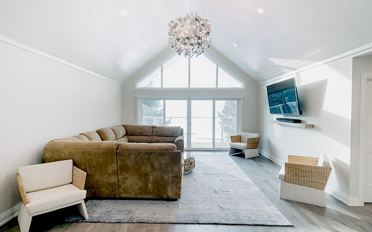 Alair Homes | Wasaga Beach Cottage | Custom | 4,500 sqft | 12 months | This Georgian Bay waterfront beach home is 4,500 sqft and features 5 bedrooms, 3.5 baths, office, gym, media room, main floor and upper floor great rooms with vaulted ceilings and a custom kitchen.