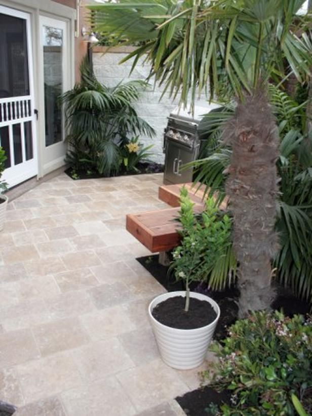 Pleasing Patio Designs : Outdoors : Home & Garden Television |   Added Space    Natural stone paving ties in with the home's interior. Thanks to designing on the diagonal, this patio looks bigger than it really is. Built-in seating maximizes the space.