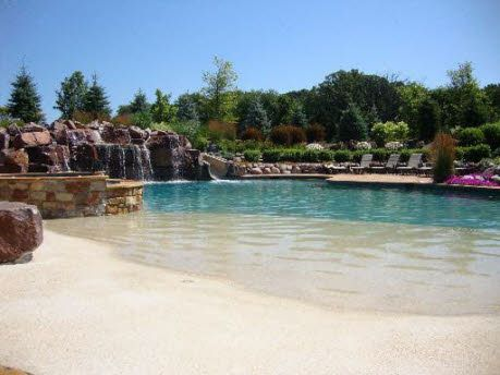 love this sandy zero entry pool. someday I'd love to have a pool.