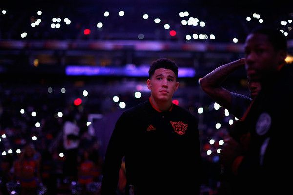 Devin Booker Photos Photos - Devin Booker #1 of the Phoenix Suns walks on the court before the start of the the NBA game against the Orlando Magic at Talking Stick Resort Arena on December 9, 2015 in Phoenix, Arizona.  NOTE TO USER: User expressly acknowledges and agrees that, by downloading and or using this photograph, User is consenting to the terms and conditions of the Getty Images License Agreement. - Orlando Magic v Phoenix Suns
