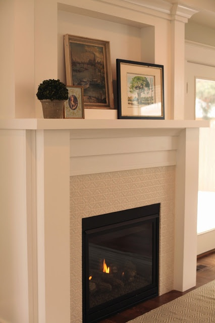 """Simple white and tile fireplace from WHITE + GOLD blog. I like the other """"after"""" pictures on this blog, too."""