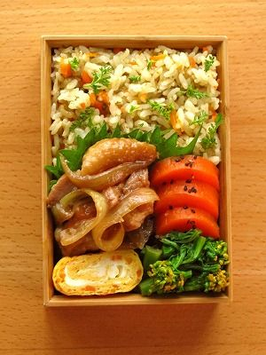 A very healthy looking bento featuring fuki no tou (butterbur sprouts) and miso rice. There's also nanohana in the bottom right corner, plus chicken, carrots and a tamagoyaki.
