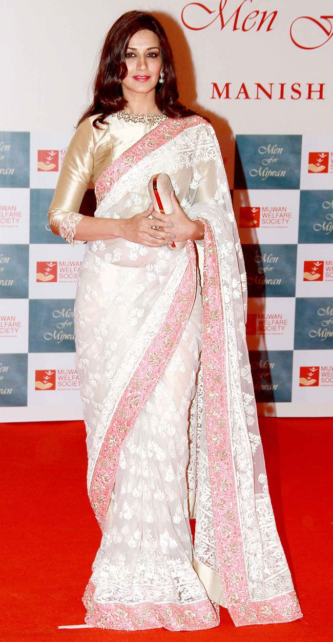 Sonali Bendre at the Mijwan Fashion Show. White, Pink & Gold #saree #sari #blouse #indian #outfit #shaadi #bridal #fashion #style #desi #designer #wedding #gorgeous #beautiful