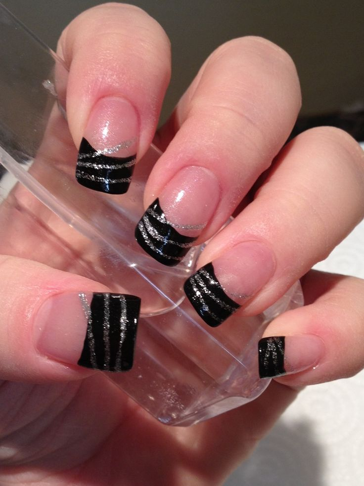 Black French tips with silver streaks by Natalie Wolfe