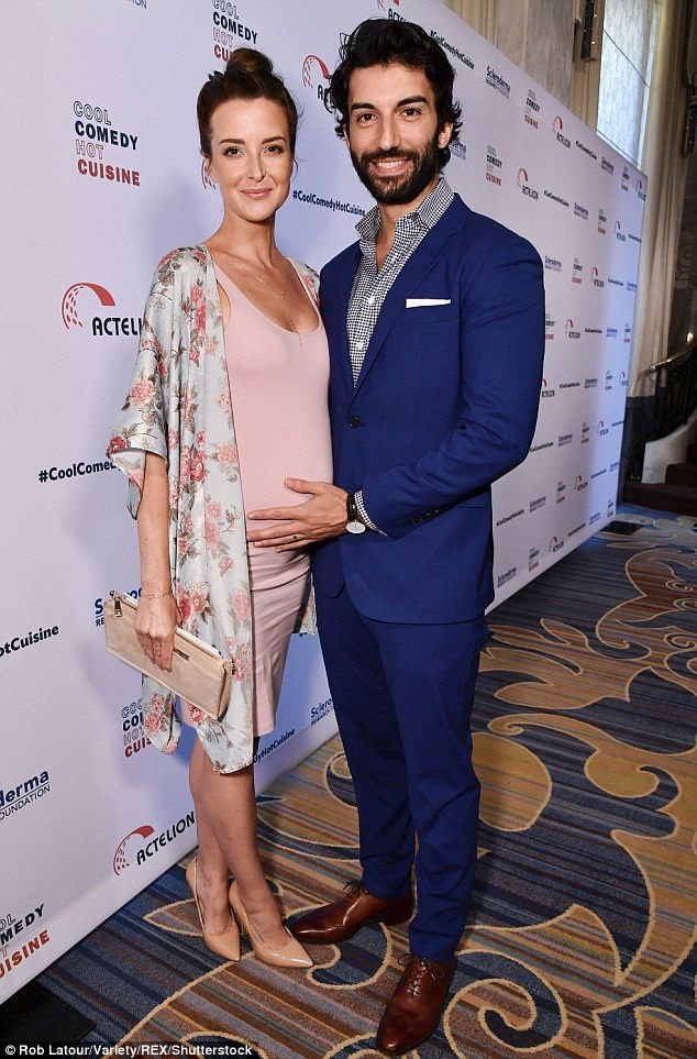 Suited up: Justin looked cool in his blue two-piece as he rested his hand lovingly on Emil...