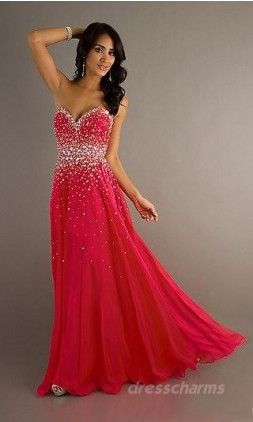 Hot pink or red ( can't tell ) strapless glitter dress