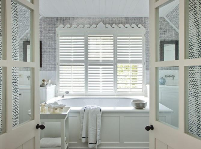 Love the window detail of this bathroom