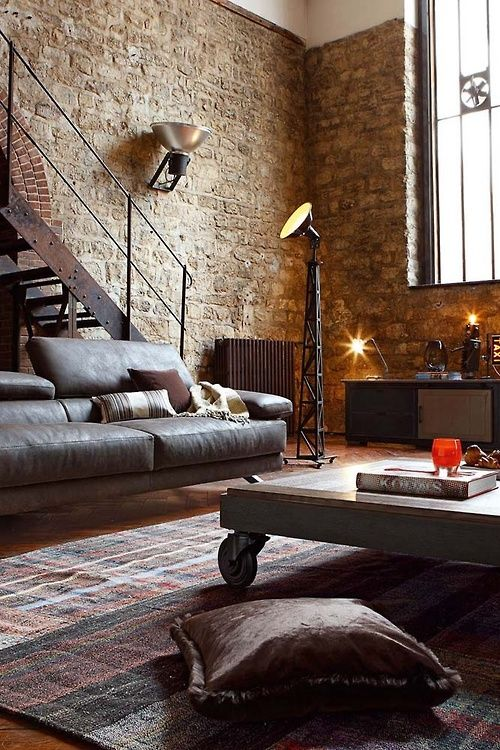 Exposed brick, leather sofa, rug.... Love it!