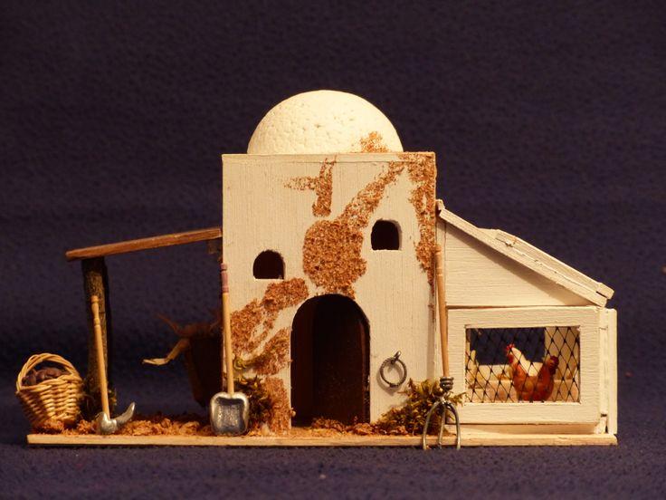 Caseta de la granja con gallinero