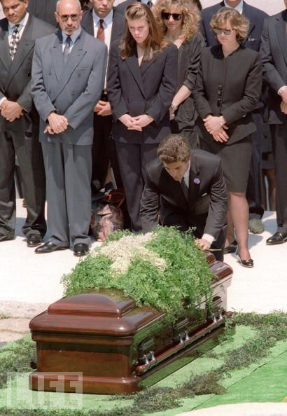 1994-05-23  At Arlington National Cemetery, John Jr. lays a flower on the casket of Jackie Kennedy Onassis