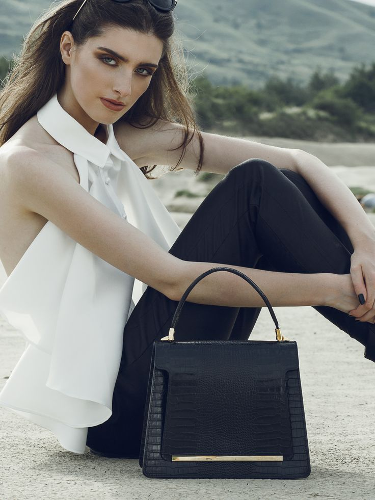 The Kelly black leather bag combines the simple yet modern design with the elegance of its refined color. These accessories can be perfect for a refined office outfit because they wonderfully capture the femininity of any clothing item. Work in style this summer next  to precious luxury bags.