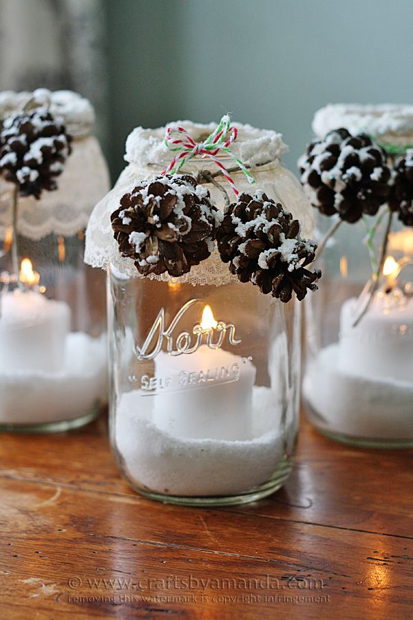 Snowy Pinecone Candle Jars  - CountryLiving.com