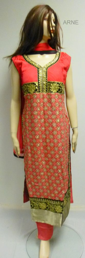 -Size 40  - Straight cut Salmon and black and gold chudidar in soft silk material  with gold and black embroidery on the border and bust line. Velvet neck  embellishment with gold print all over the top.   - Sleeves attached  - Salmon and black chiffon dupatta