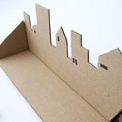Make a trinket shelf of a cardboardbox. Tutorial in Swedish and English.