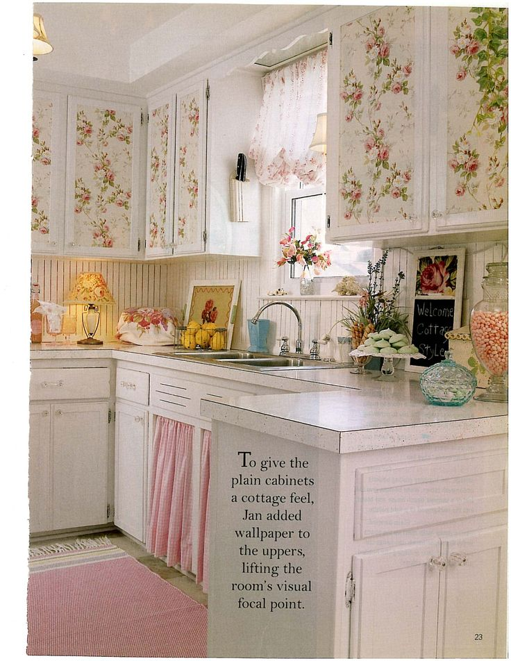 Floral wallpaper with roses on cupboards, attractive displays on counter and under sink curtain~lovely.