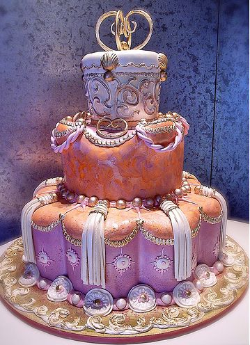 The textured finish on the middle tear is gorgeous. I also like the pearl details and the overall luxuriousness of the cake. Cake by Rosebud Cakes.