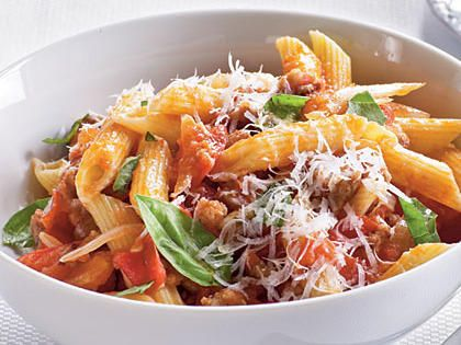 Fresh Tomato, Sausage, and Pecorino Pasta | Ripe, summer tomatoes are juicy and delicious in this pasta dish, with no seeding or peeling necessary.