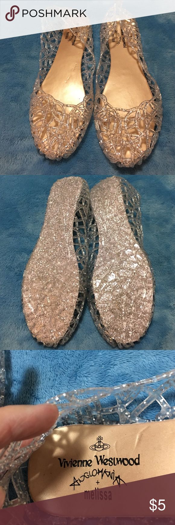 Adult silver sparkly jelly shoes. I can't believe these are back adult size! I wore the a few times looks cute with shorts leggings or give them to your daughter Shoes Sandals