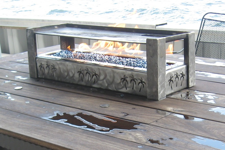This fire table features a raised centre. As all our tables are made to order, we can customize your fire table to your exact desires - right down to the last detail. www.sunsetmetalfab.com