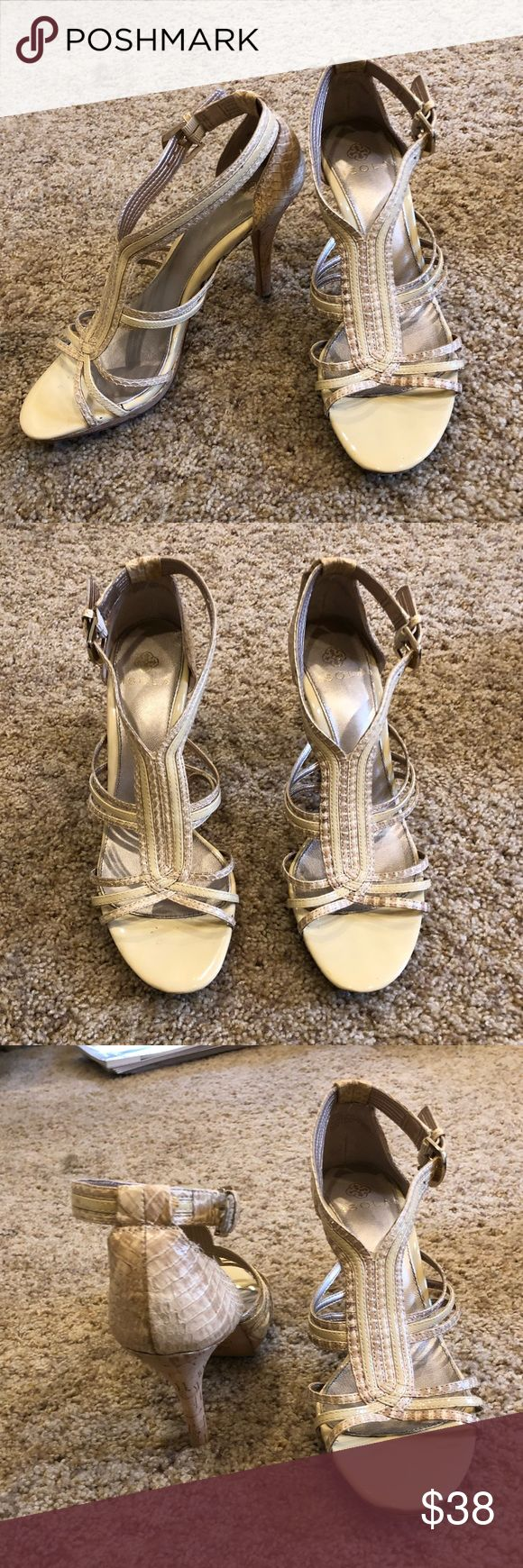 Tan Strappy Heels Tan strappy heels. Very nice shoes. In great condition. Have only been worn once. Isola size 7.5. Shoes Heels