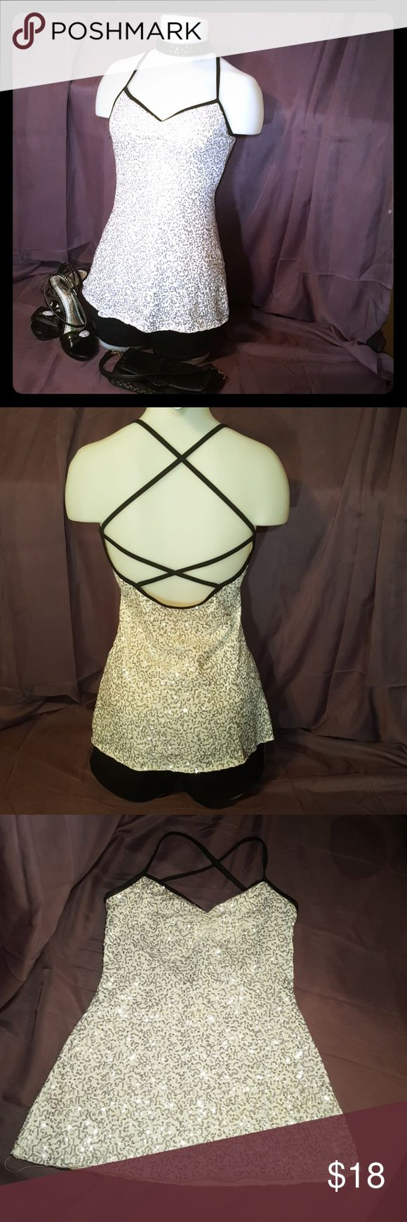💋SEXY White V-Neck Sequin Top This top would be perfect for ladies night🍷 or New Year's Eve!🍾 it is white with silver sequin and black trim,  v-neck fully lined with a low-cut strappy back! It's polyester spandex so it's got a little bit of stretch to it and it's longer in length. It goes to about mid hip on me and I'm 5 3 Very sexy When on! Size S Tops Tunics