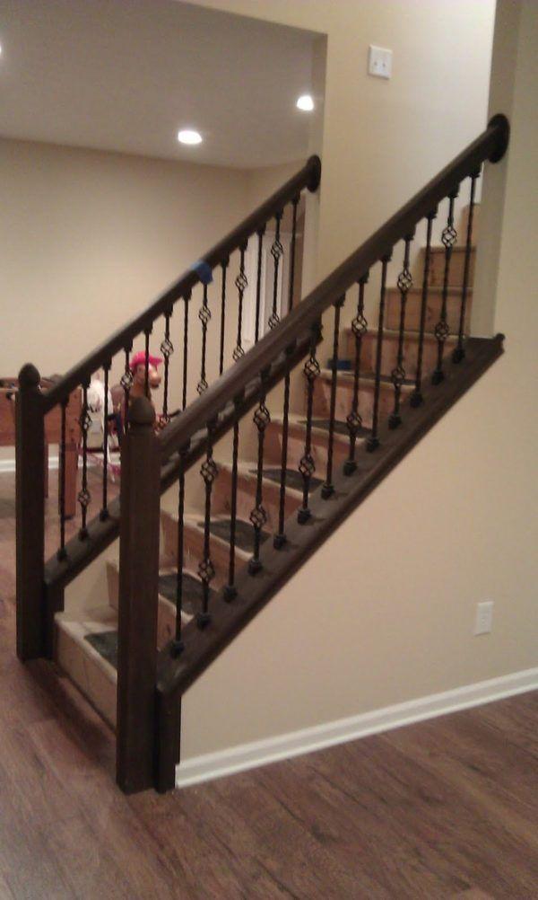Image Of Cream Wall Paint Color Between Black Metal Art Balusters Behind Dark Brown Wooden Han Stair Railing Design Modern Stair Railing Interior Stair Railing