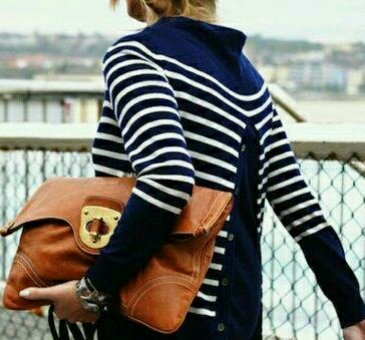 striped sweater. leather bag.