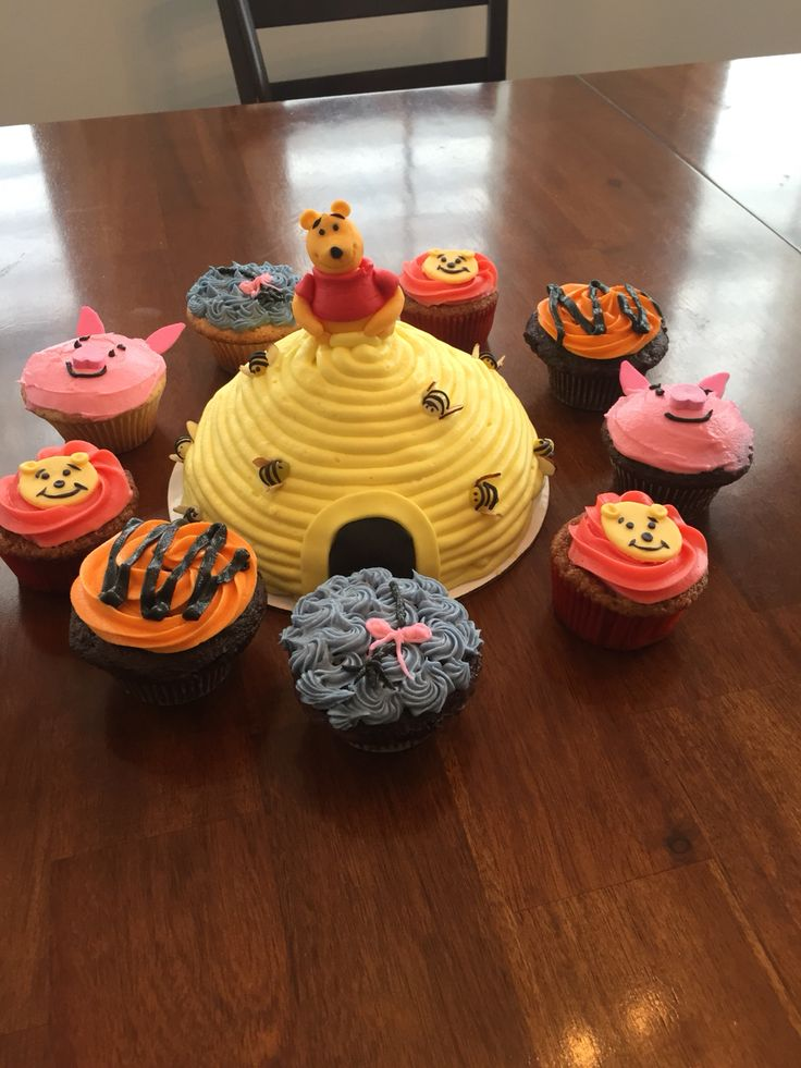 Winnie the Pooh cupcakes and smash cake for first birthday