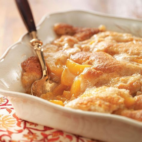 Tennessee Peach Pudding Recipe -Prepared with fresh peaches, this dessert is out of this world. I was raised in Oklahoma, and we used Elberta peaches right off our trees when we made this outstanding cobbler. —Virginia Crowell, Lyons, Oregon
